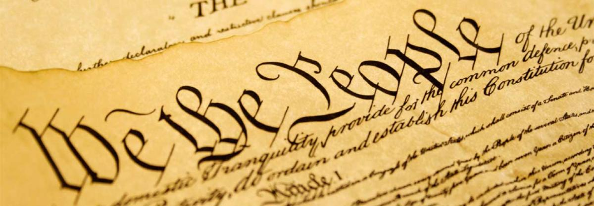 "closeup of ""We the People"" text of the Constitution"
