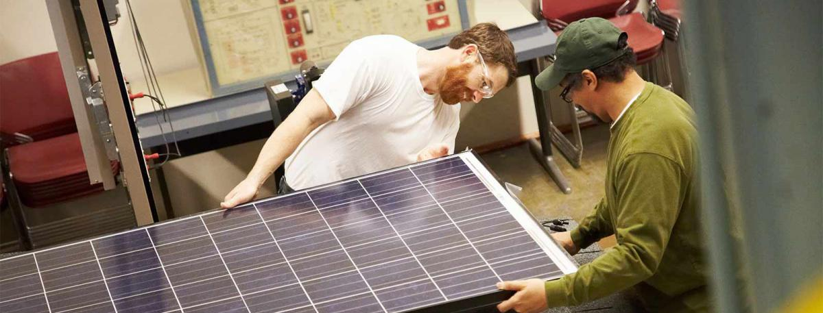 Two workers on a solar panel