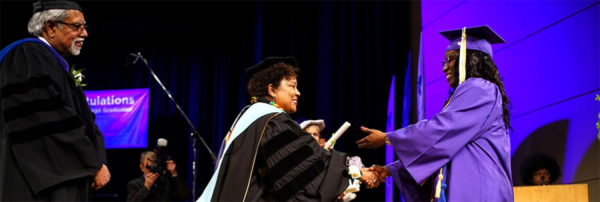 student receiving their diploma in 2019