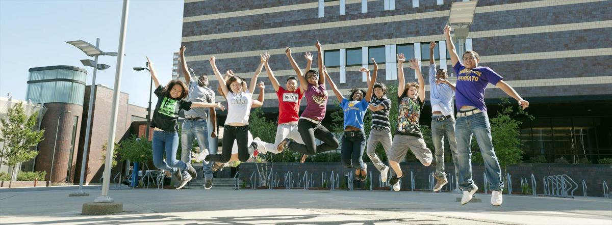 students jumping in mid-air