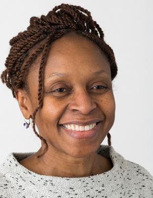Dr. Tolu Oyelowo smiling